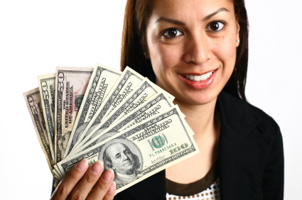 Woman smiling holding money. TNL Car Title Loans can help you get a fast loan!