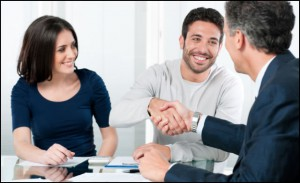 Man shaking hand and smiling. TNL Car Title Loans can help you get a loan!