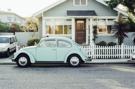 volkswagen parked in front of house