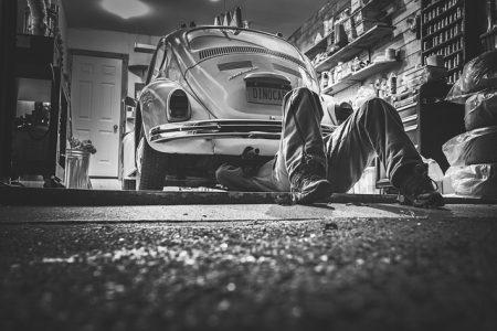 mechanic fixing volkswagen