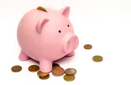 Piggy bank and coins. TNL Car Title Loans can help you get the cash you need!