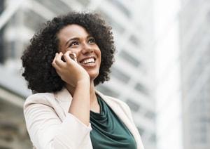 Woman talking on phone. TNL Car Title Loans